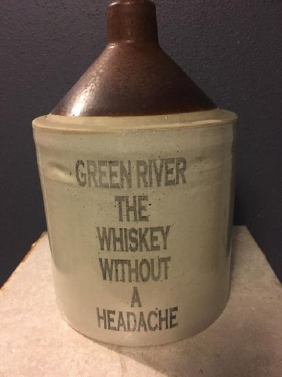 Fake jug with stenciled lettering with Green River slogan.